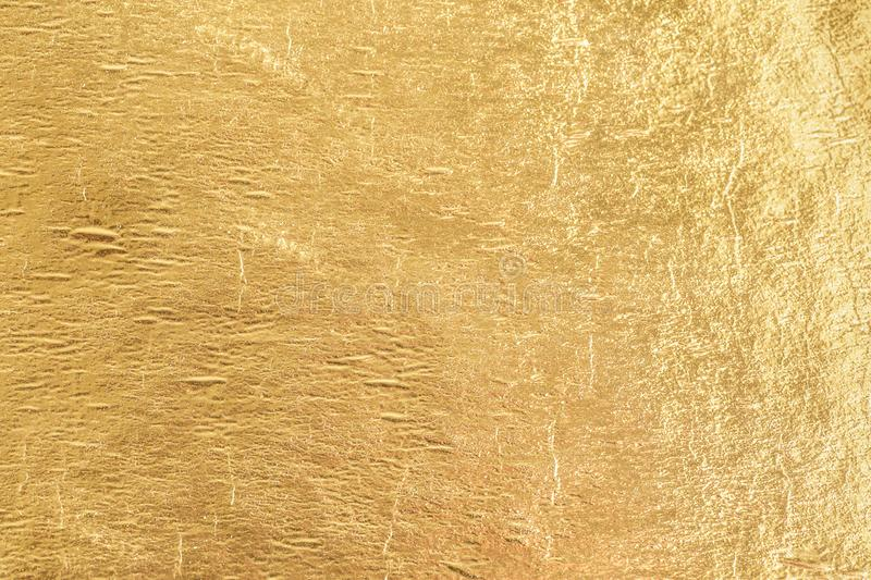Gold shiny foil background, yellow gloss metallic texture royalty free stock photo