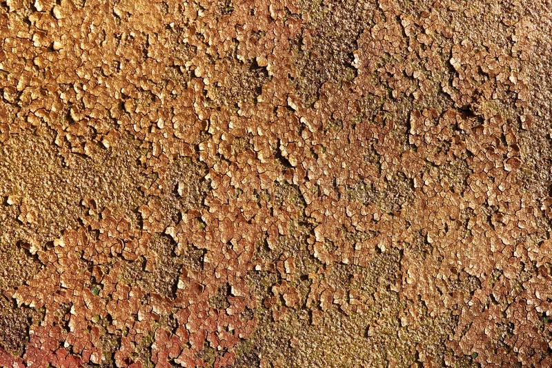 Gold shiny glitter texture background. Background texture of old rusty metal with cracked paint. Background texture of old rusty metal with cracked paint royalty free stock photo