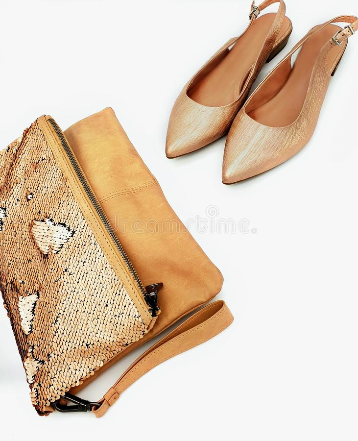 Gold shoes handbag women accessories luxury stylish fashion trends clothes copy space  background isolate. Shopping for girl store business stock images