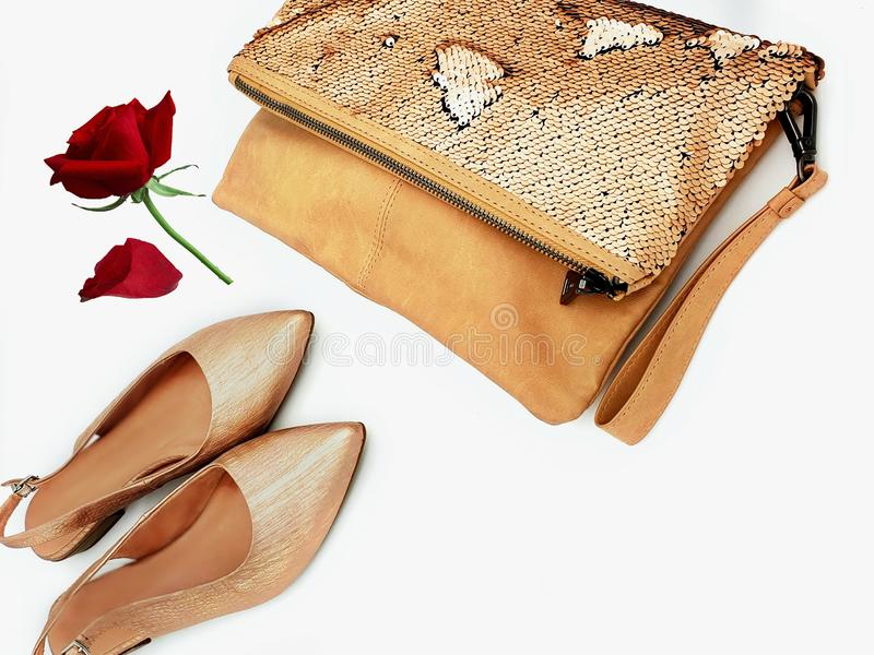 Gold shoes handbag women accessories luxury stylish fashion trends clothes copy space  background isolate. Shopping for girl store business stock photos