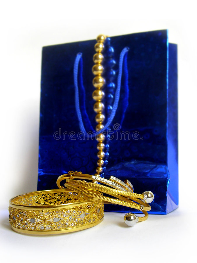 Free Gold Shopping Royalty Free Stock Photo - 700675