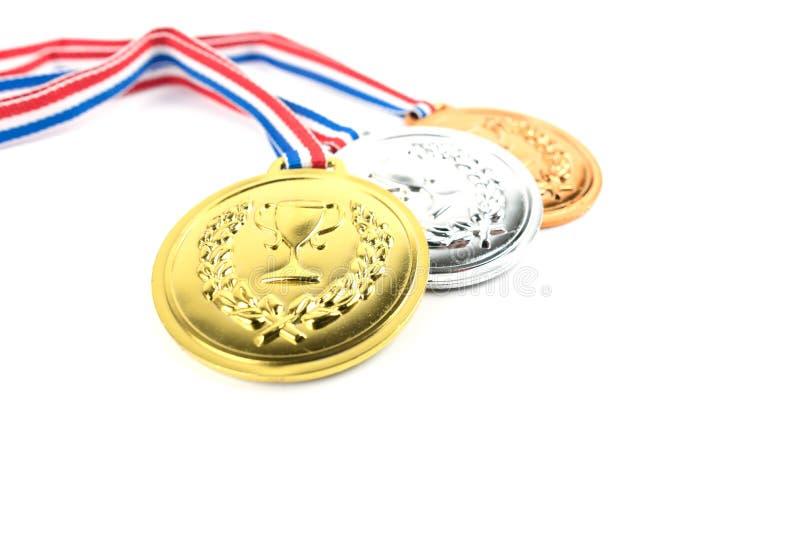 Gold-, silberne und Bronzemedaillen stockbild