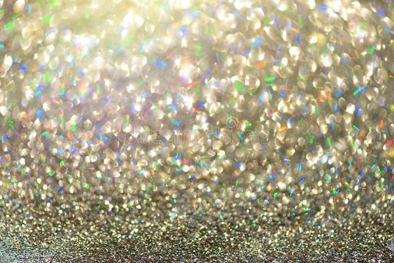 Gold and silver abstract bokeh lights. Shiny glitter background with copy space. New year and Christmas concept. Sparkling royalty free stock photography