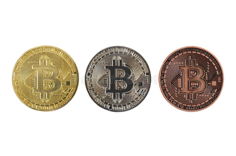 Gold silver and bronze bitcoin coins on white background stock image