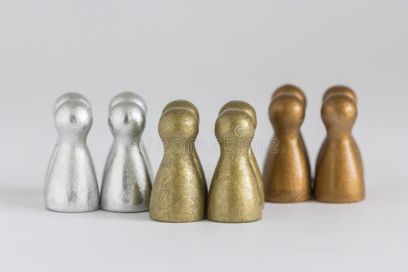 Gold, Silver, Bronze team. Playful Concepts: Gamefigurines representing gold, silver and bronze teams stock photo