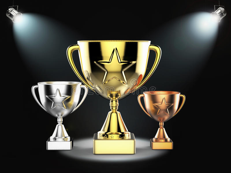 Gold, silver and bronze trophy on stage royalty free stock photo