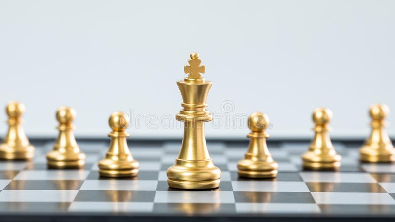 Gold and silver chess. In the white background. Business leader concept for market target strategy. Intelligence challenge and business competition success play royalty free stock images