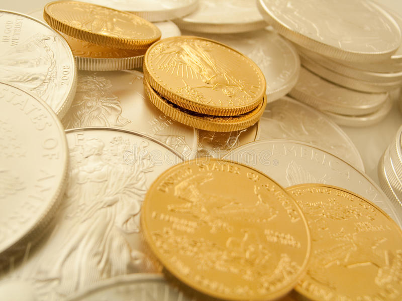 Gold And Silver Coins. American gold and silver coins royalty free stock photos