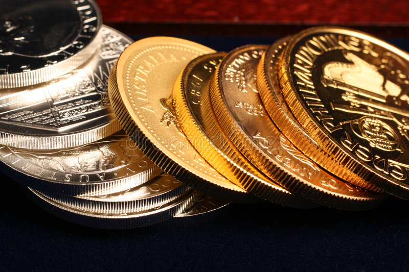 Gold and silver coins. Close-up gold and silver coins royalty free stock images
