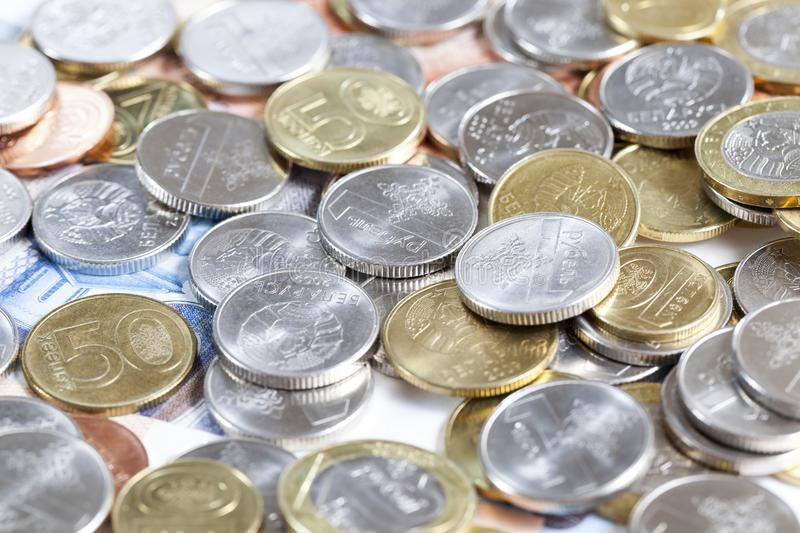 Gold and silver coins. Scattered in a chaotic order, photo closeup of the Belarus money royalty free stock photo