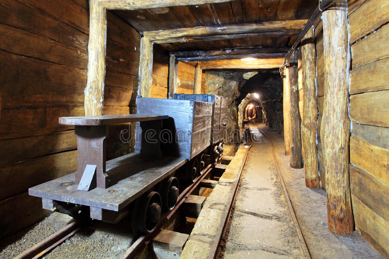 Gold, silver and cooper mine. Wagons and machine in gold, silver and cooper mine stock images