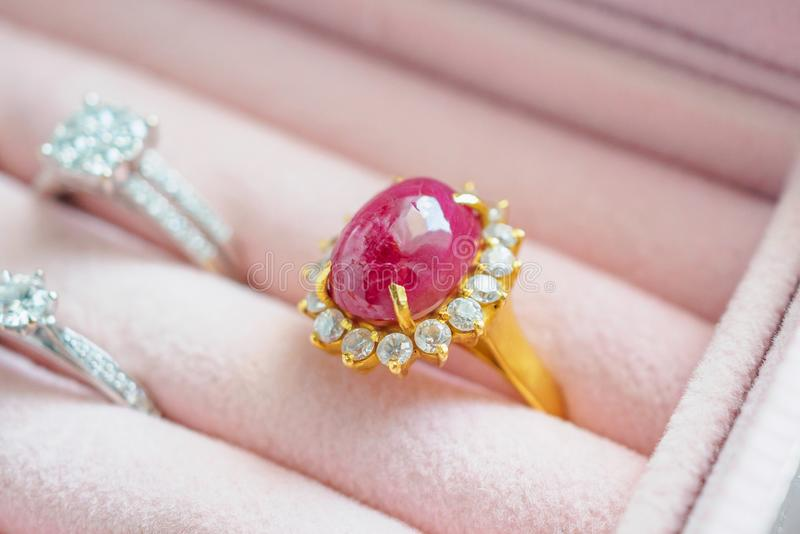 Gold and silver diamond ruby gemstone ring in jewelry box royalty free stock photo