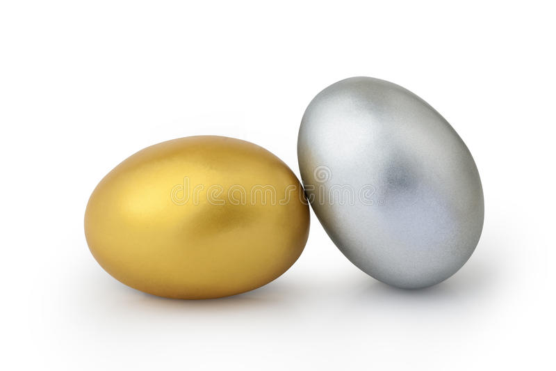 Gold and silver eggs. On white background stock photography