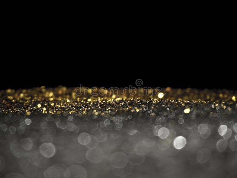 Gold and Silver glitter with bokeh,Black background stock photos