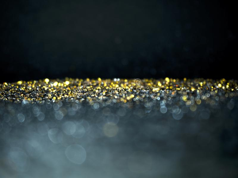 Gold Silver glitter with bokeh,Black background stock photos