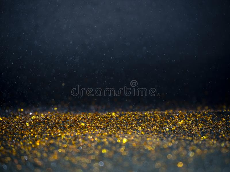 Gold and Silver glitter with bokeh,Black background stock images