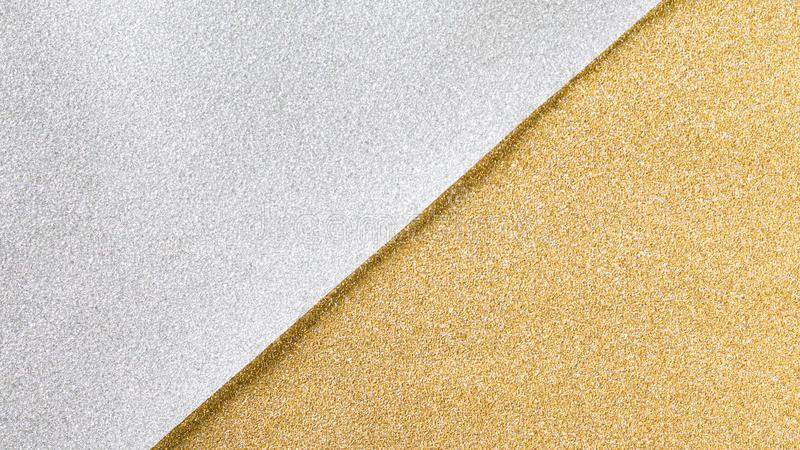 Gold and silver glitter paper background. Gold and silver glitter background, two tone christmas wrapping paper stock images