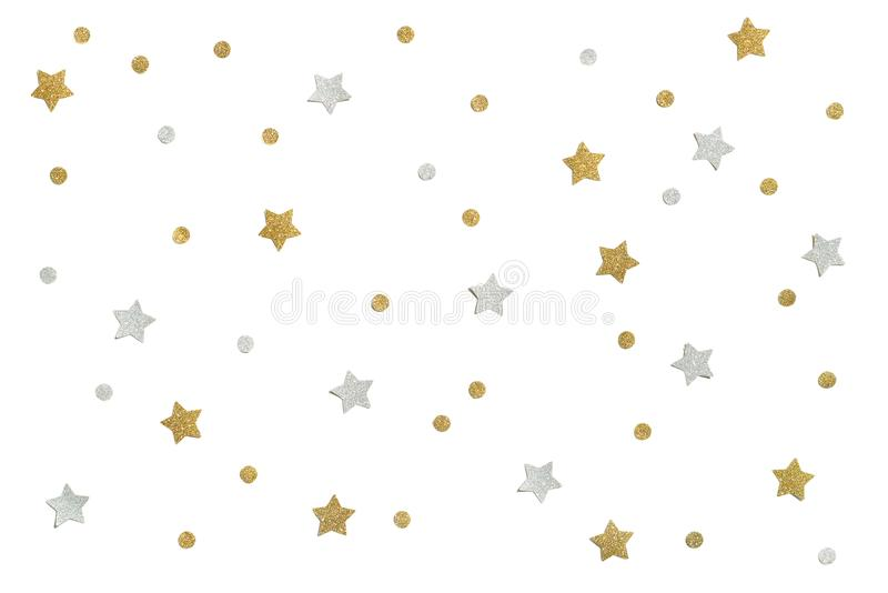 Gold and silver glitter star paper cut on white background. Isolated stock image