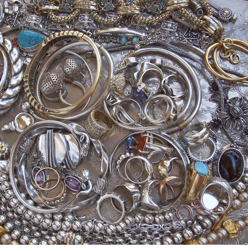 Gold and silver jewels closeup royalty free stock photos