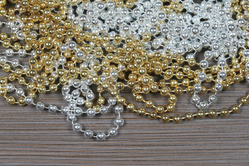 Gold silver pearls. Pile of shiny gold and silver pearl necklaces stock photography