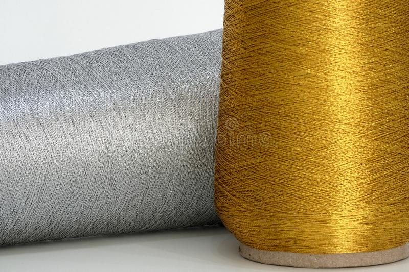 Gold and silver sewing thread - close-up. A close-up of gold and silver sewing thread. Each string is clearly visible royalty free stock photos