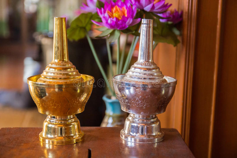 Gold silver Thai bottle royalty free stock photography