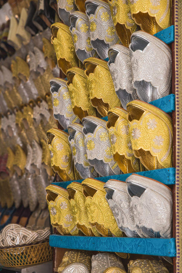 The gold and silver traditional shoes of Morocco made from cloth royalty free stock images