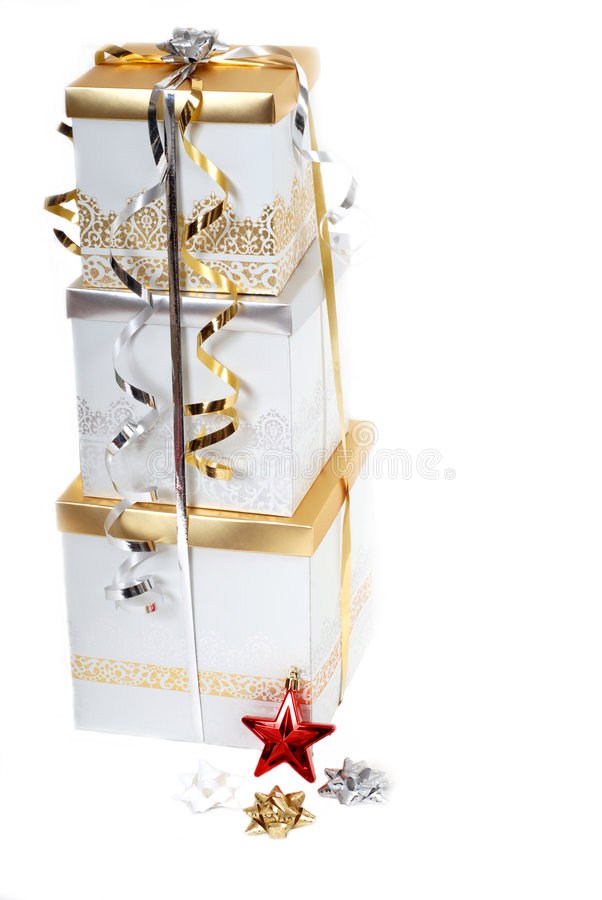 Gold and silver wrapped Christmas gifts royalty free stock images