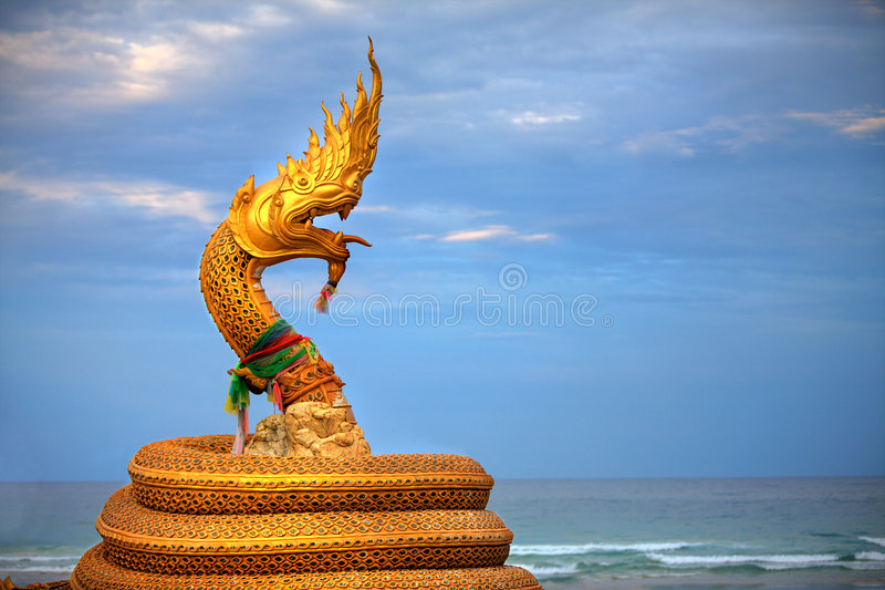 Gold Snake Statue. Large statue of golden snake / dragon creature stock photos