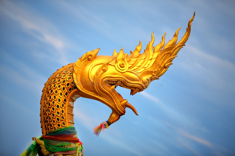 Gold Snake Statue. Large statue of golden snake / dragon creature royalty free stock photos