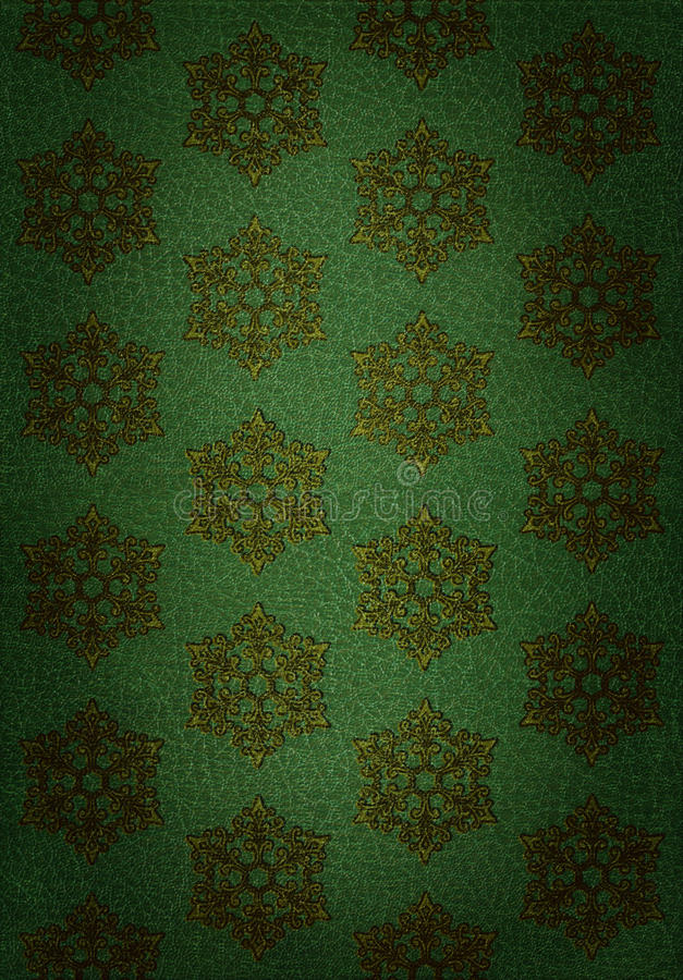 Gold Snowflake Pattern on Green Leather stock image