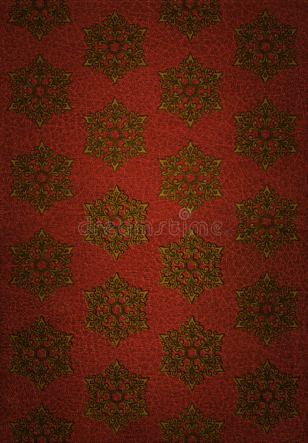 Gold Snowflake Pattern on Red Leather stock photo