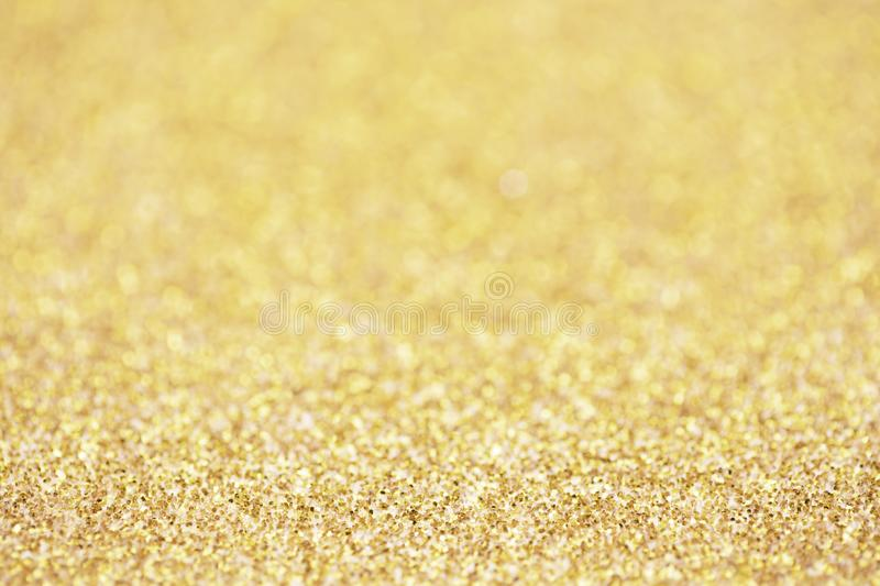 Gold sparkle glitter for Christmas background.  royalty free stock photo