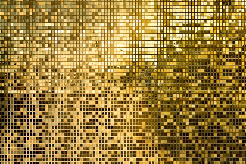 Gold square mosaic tiles for texture background. Gold yellow square mosaic tiles for texture background royalty free stock photos