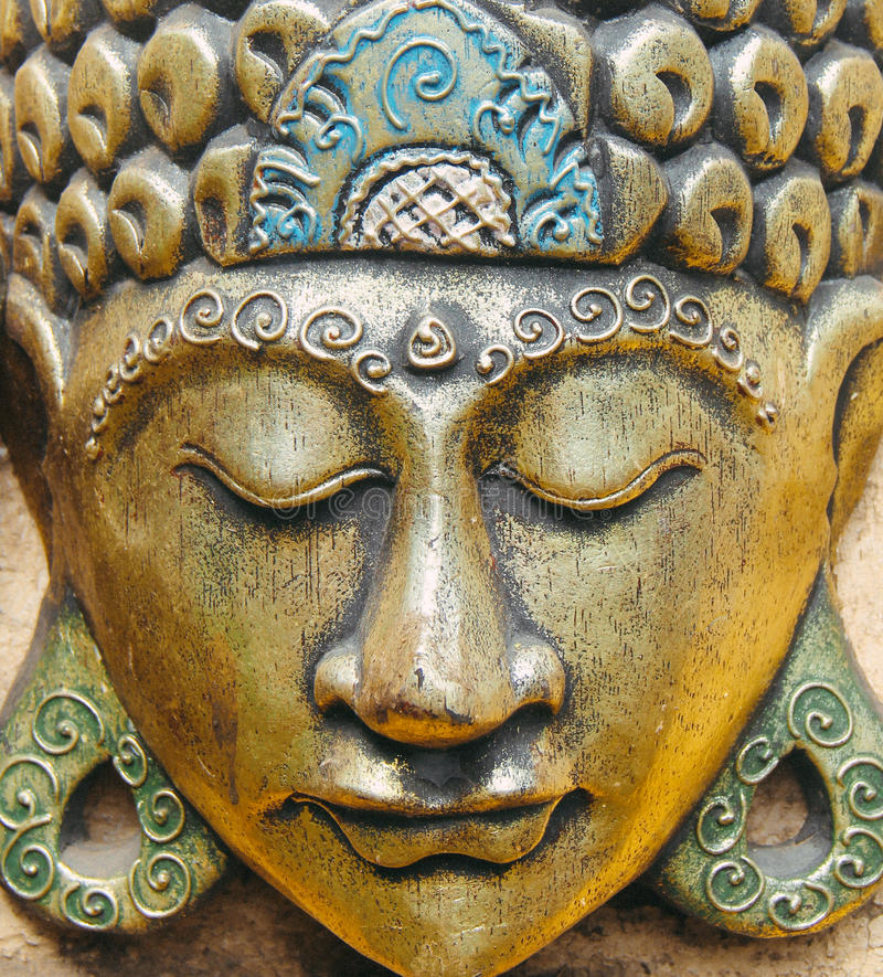 Gold statuette of Buddha head stock photography