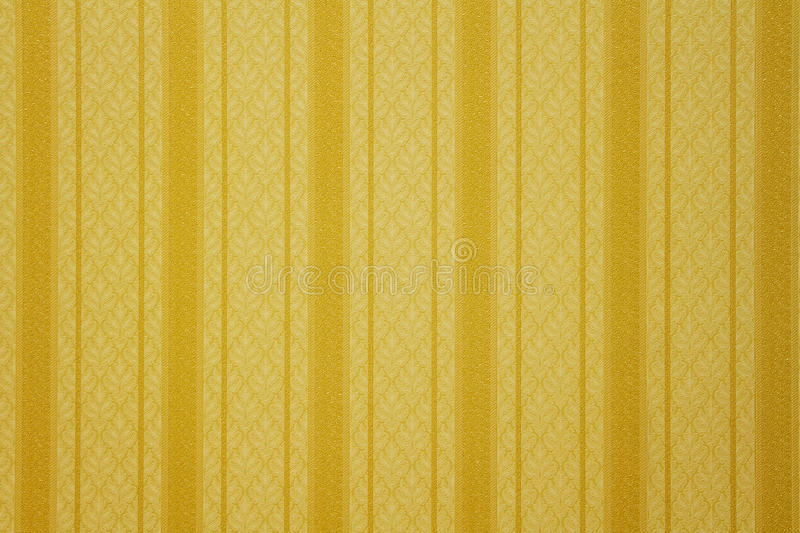Gold striped wallpaper. With floral pattern royalty free stock photos