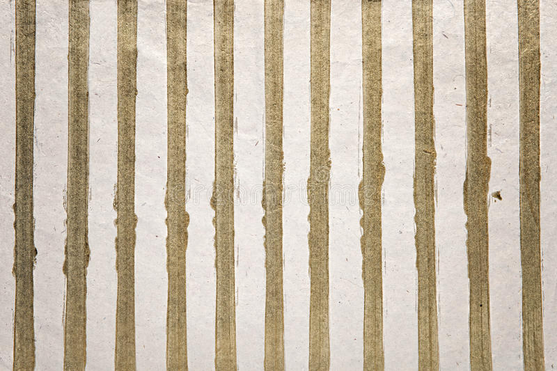 Gold stripes background. Of glitter on a textured white background for a special occasion or celebration stock image