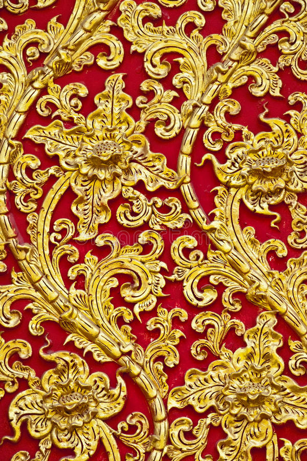 The gold stucco design of native thai style on the stock photo