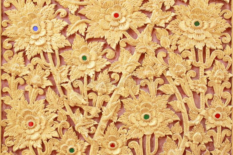 The gold stucco design of native thai style on the Wall royalty free stock photos