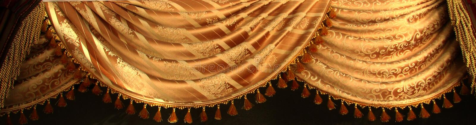 gold swag curtain with design royalty free stock photo