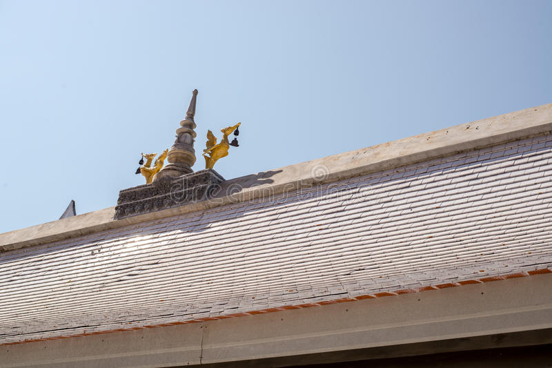Gold swan lamp on the roof. Of temple stock image