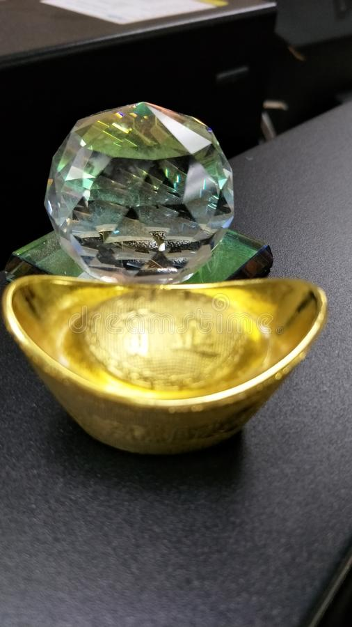 Gold Talisman and Reflection in the glass stock image