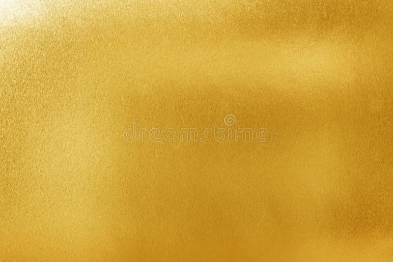 Gold texture background for design. Shiny yellow metal or foil surface material.  stock photography