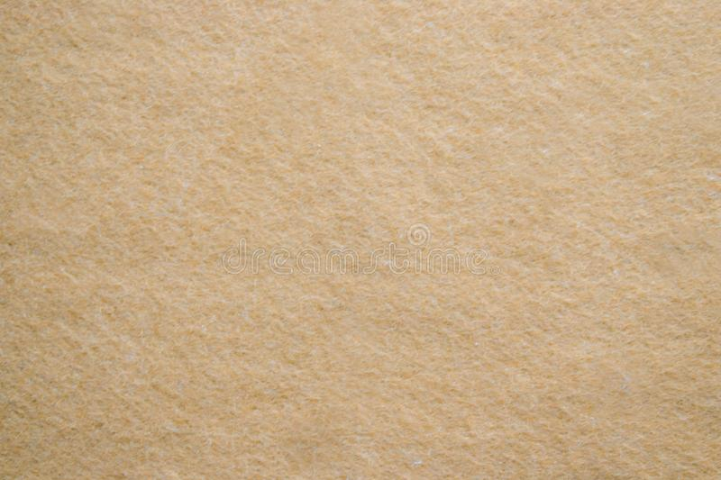 Gold texture background paper in yellow vintage cream or beige color, parchment paper, abstract pastel gold gradient. royalty free stock photo