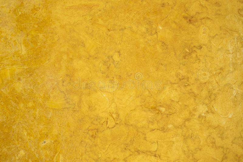 Gold textured polished marbled stone surface background royalty free stock photo