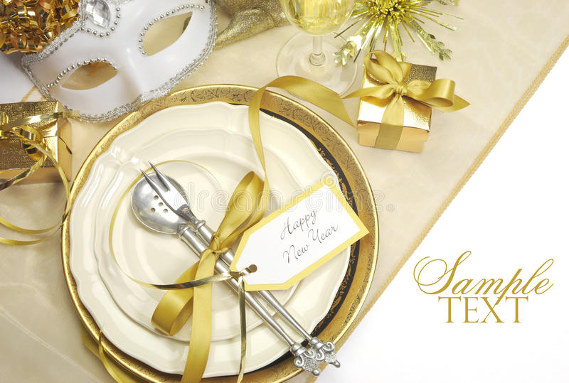 Gold theme elegant Happy New Year dining table place settings royalty free stock photography