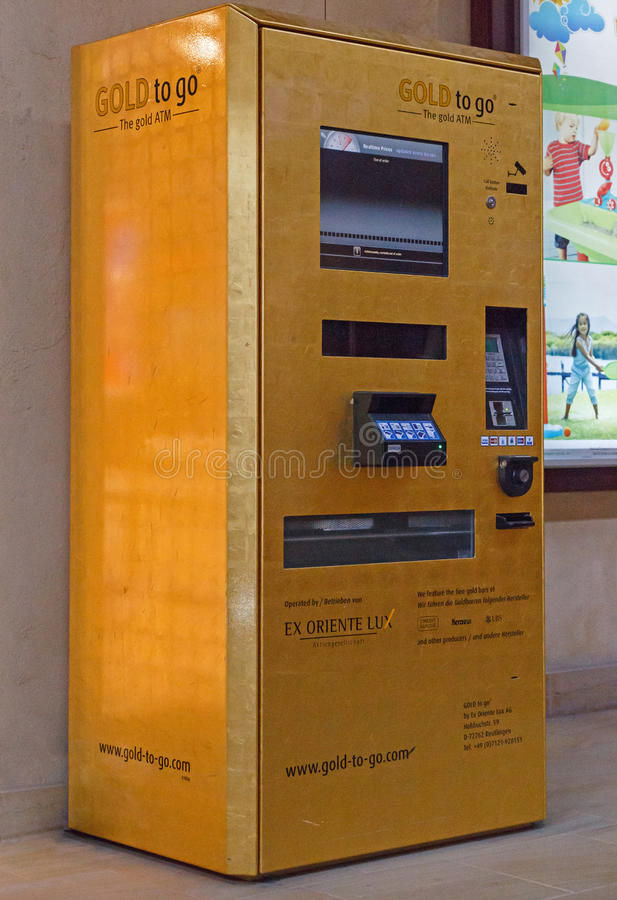 Gold to go ATM stock images