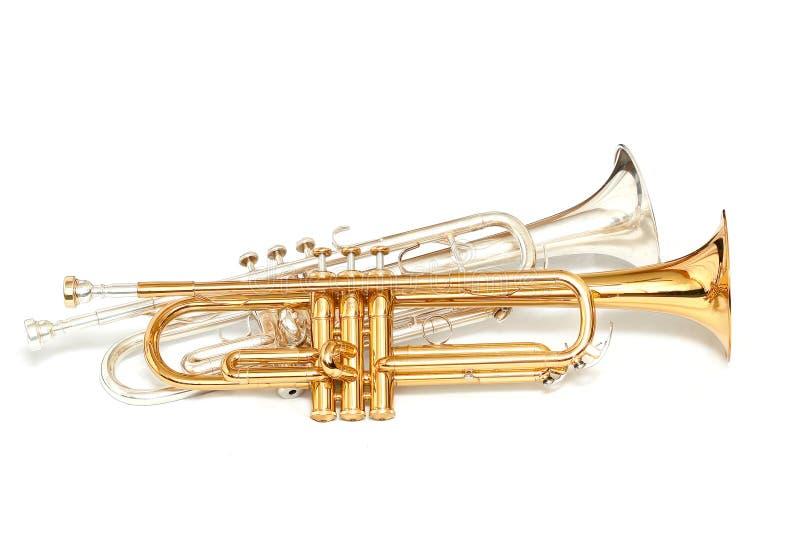 Gold- und Silbertrompeten stockbilder