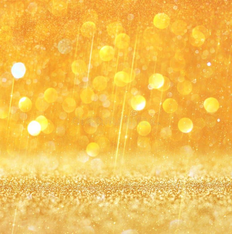 Gold und warme abstrakte bokeh Lichter Defocused Hintergrund lizenzfreie stockfotos