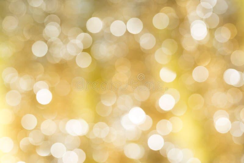 Gold unscharfes abstraktes bokeh Licht backgound stockfotos